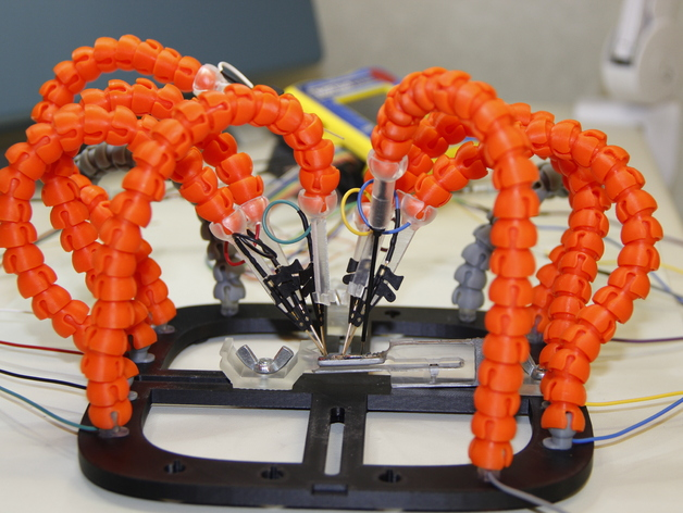 A PCB workstation comprised of mobile arms holding wires up against a PCB for testing