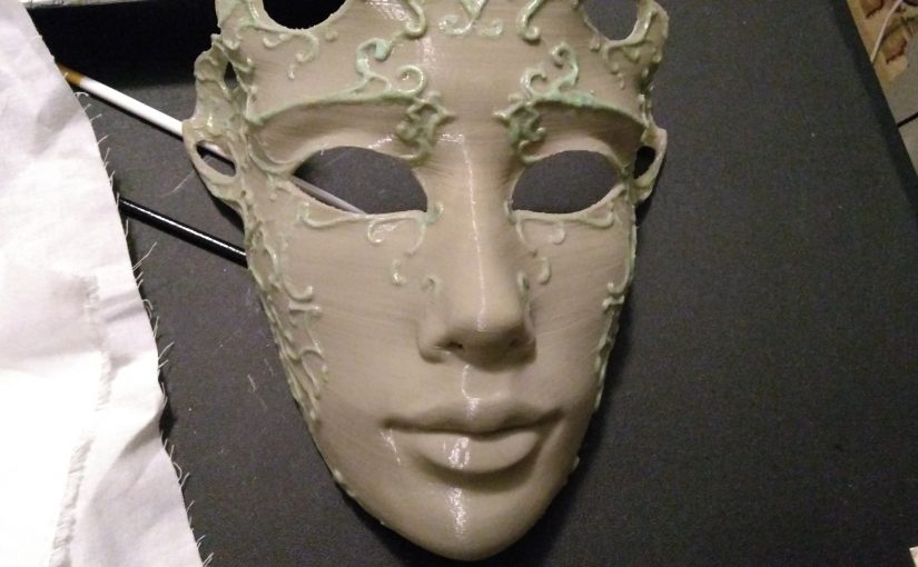 Grey colored ball mask. The green highlights are glow in the dark ABS plastic painted onto the surface.